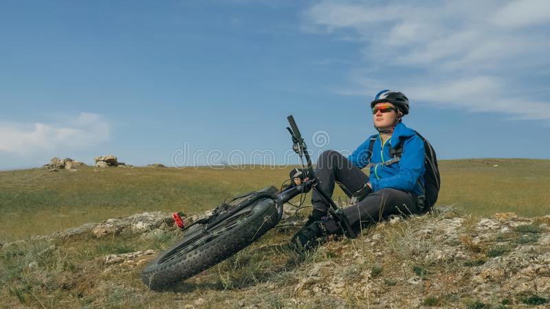 Fat bike also called fatbike or fat-tire bike in summer driving the hills. Fat bike also called fatbike or fat-tire bike in summer driving through the hills stock photography