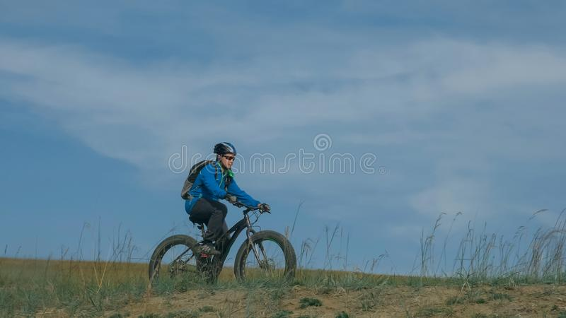 Fat bike also called fatbike or fat-tire bike in summer driving the hills. Fat bike also called fatbike or fat-tire bike in summer driving through the hills stock image