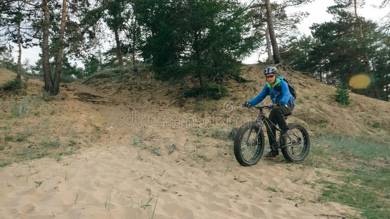 Fat bike also called fatbike or fat-tire bike in summer driving the hills. Fat bike also called fatbike or fat-tire bike in summer driving through the hills royalty free stock photography