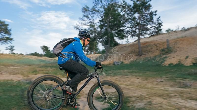 Fat bike also called fatbike or fat-tire bike in summer driving the hills. Fat bike also called fatbike or fat-tire bike in summer driving through the hills royalty free stock photo