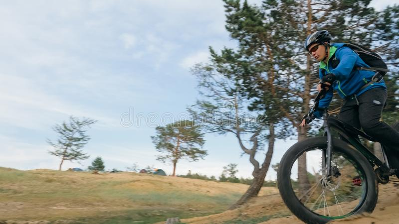 Fat bike also called fatbike or fat-tire bike in summer driving the hills. Fat bike also called fatbike or fat-tire bike in summer driving through the hills royalty free stock image