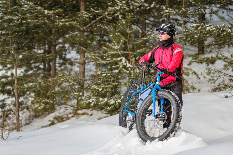 Fat bike. Fat tire bike. A young man riding fat bicycle in the winter. A young man riding fat bicycle in the winter. winter biking. Fatbike. Fat tire bike stock images