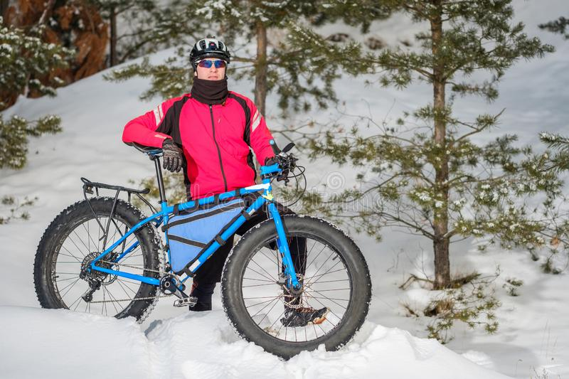 Fat bike. Fat tire bike. A young man riding fat bicycle in the winter. A young man riding fat bicycle in the winter. winter biking. Fatbike. Fat tire bike royalty free stock images