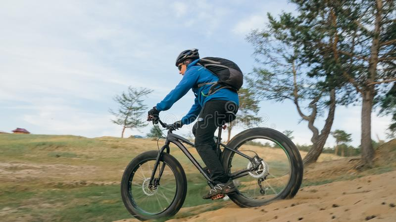 Fat bike or fatbike or fat-tire bike in summer driving through the hills. Fat bike also called fatbike or fat-tire bike in summer driving through the hills. The stock photos