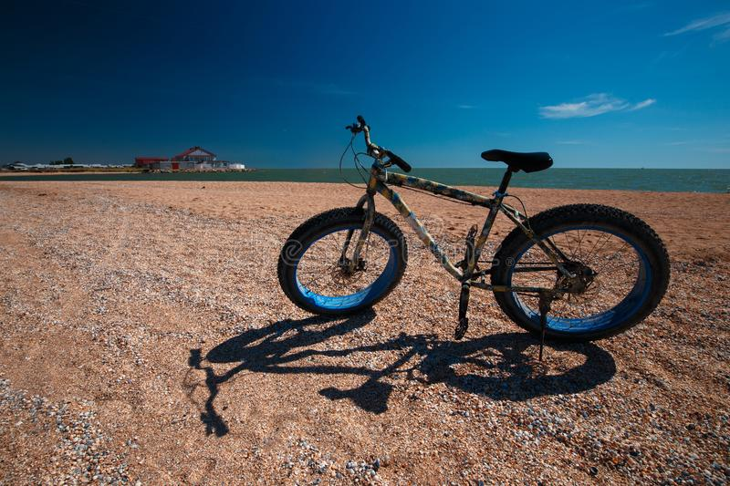 Fat Bike in the summer on the beach. Cycling and active lifestyle stock photo