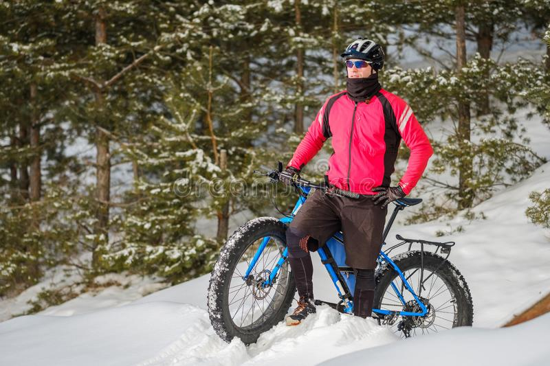 Fat bike. Fat tire bike. A young man riding fat bicycle in the winter. A young man riding fat bicycle in the winter. winter biking. Fatbike. Fat tire bike stock photo