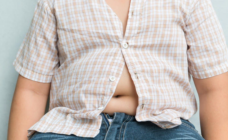Fat boy overweight. Tight shirt. royalty free stock photos