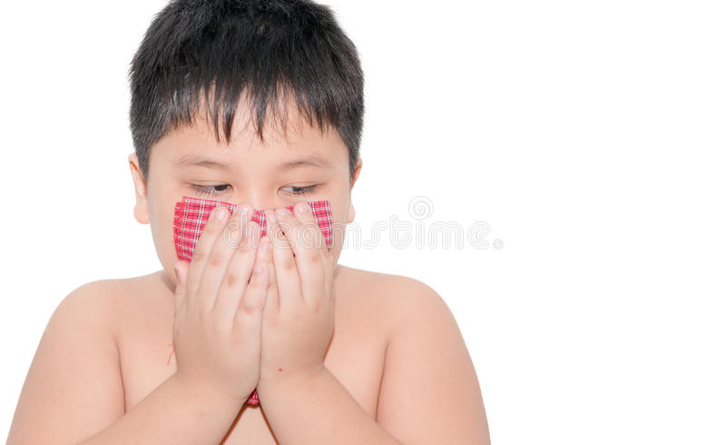 Fat boy Use a handkerchief when coughing isolated royalty free stock image