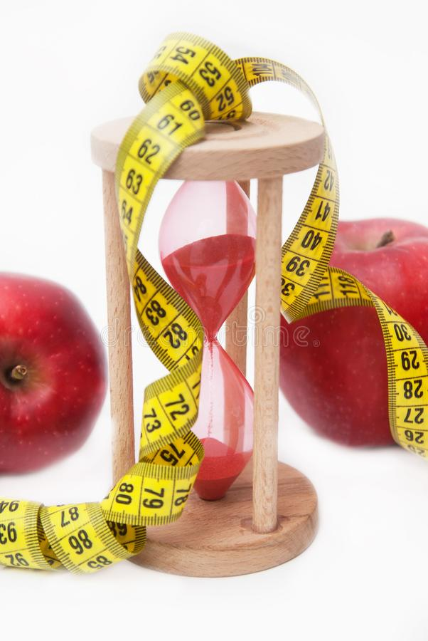Free Fat Burning And Weight Loss Process. Diet And Fitness Concept. Red Apple And Tape Measure Isolated, Close Up. White Background. Ve Royalty Free Stock Photos - 110389078