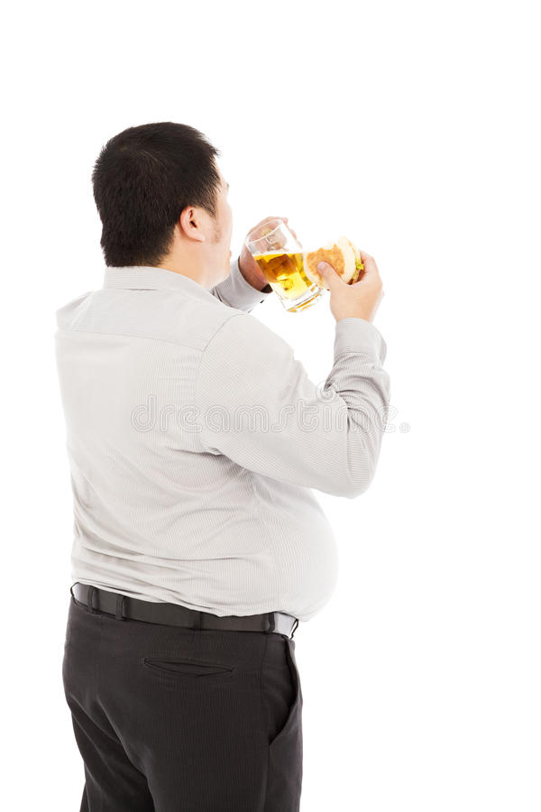 Fat business man is overeating. isolated on a white. Background stock photography
