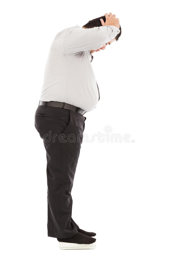 Fat business man too unbelievable his weight to hold head. Isolated on a white royalty free stock photography