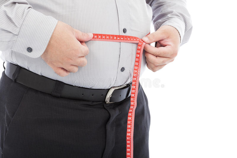 Fat business man use scale to measure his waistline. In studio stock image