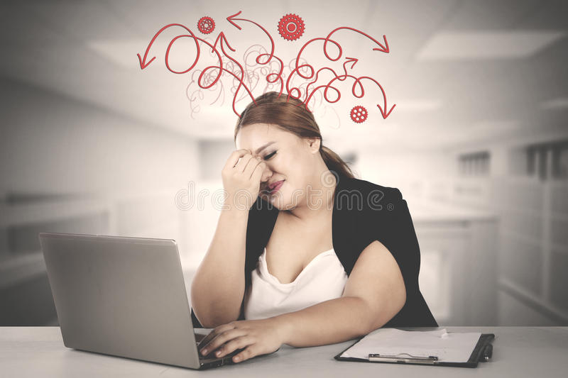 Fat businesswoman having messy thought stock photo