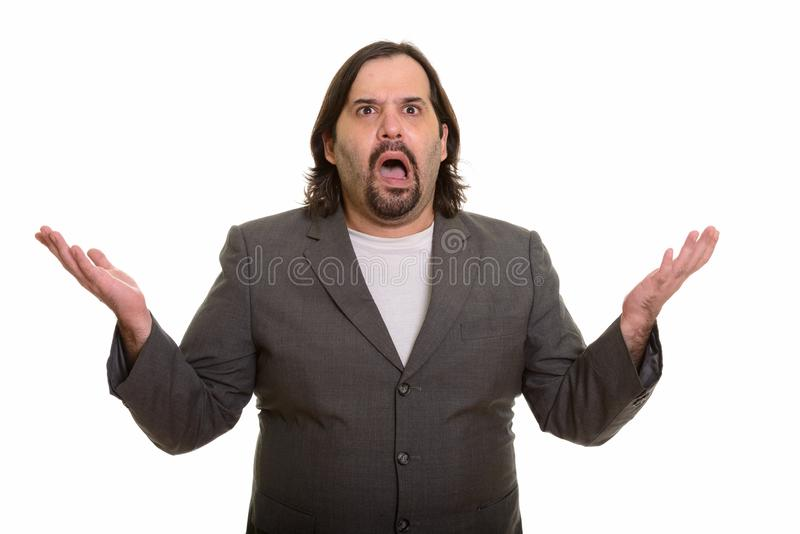 Fat Caucasian businessman looking confused and shrugging shoulders. Fat Caucasian businessman looking confused isolated against white background stock photos