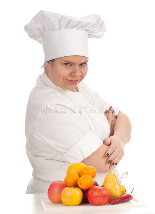 Fat female cook with fruits, series. Fat female cook in white uniform and hat with fruits, series royalty free stock photos