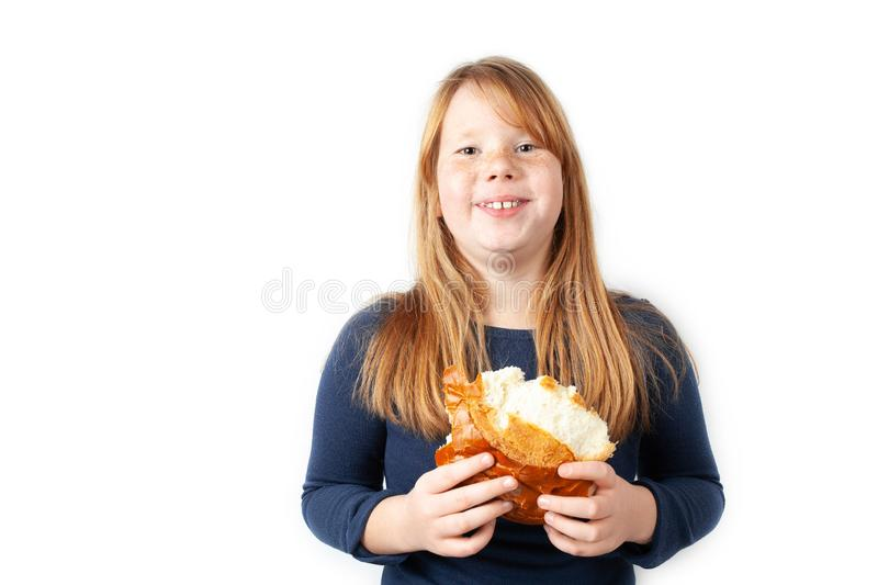 Fat girl eats sweet loaf and laughs. Obesity, overeating.  stock images