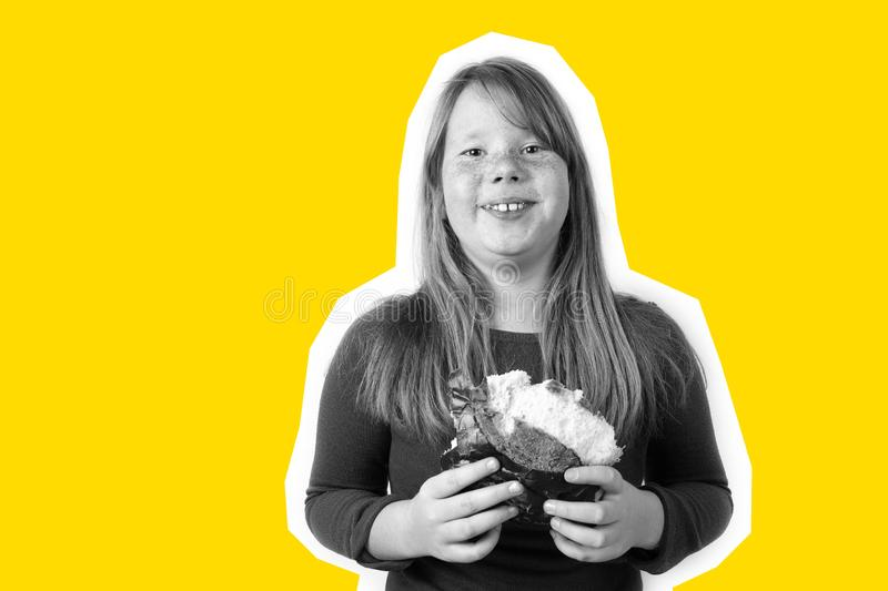 Fat girl eats sweet loaf and laughs. Obesity, overeating royalty free stock images
