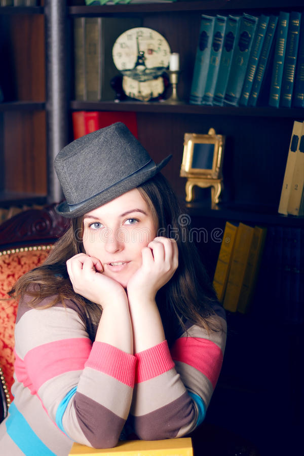 Girl In A Striped Sweater And Hat Stock Images