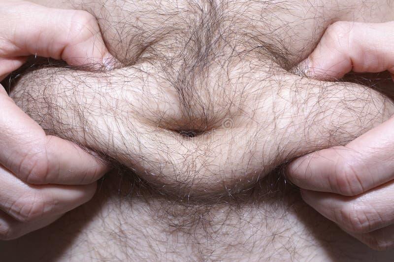 Fat man. Detail of a fat man - belly