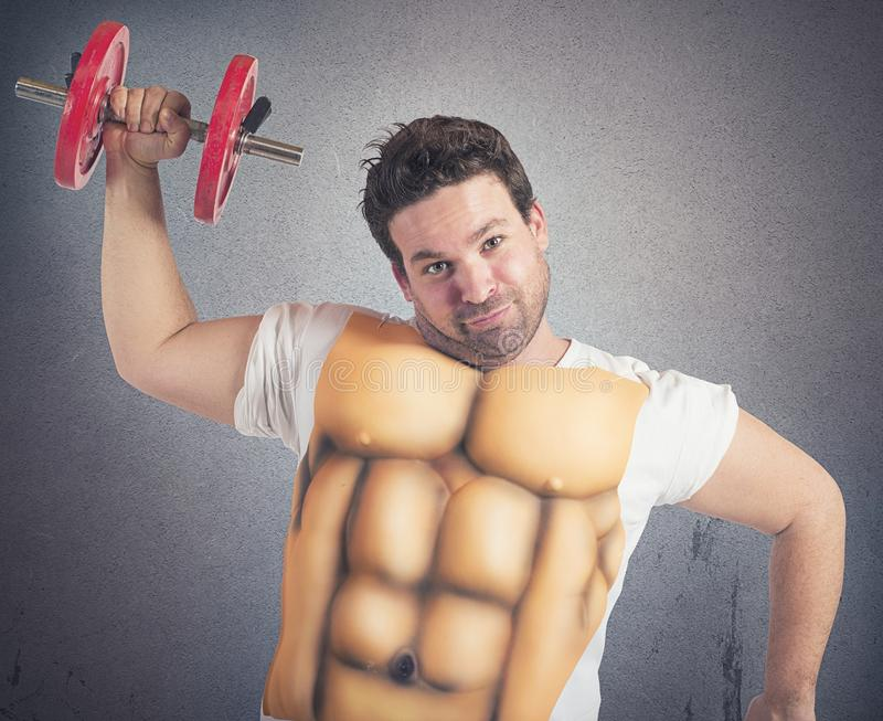 Fat man with abs. Ironic fat man does gym with abs royalty free stock photo