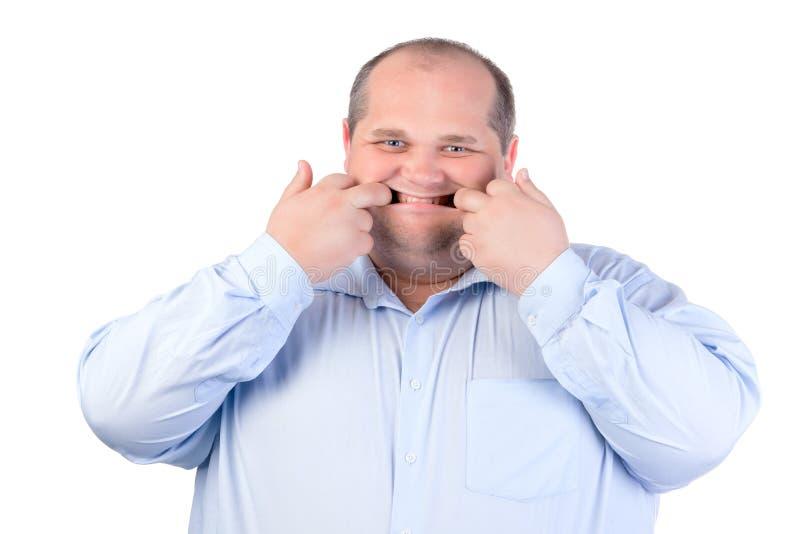 Fat Man In A Blue Shirt, Contorts Antics Stock Image