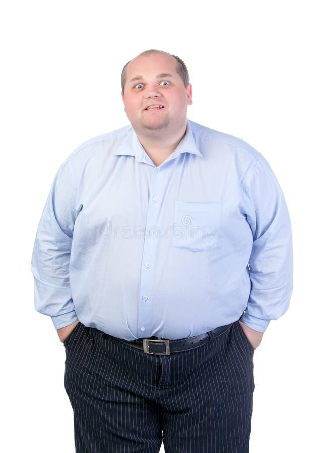 Fat Man In A Blue Shirt, Contorts Antics Stock Photography