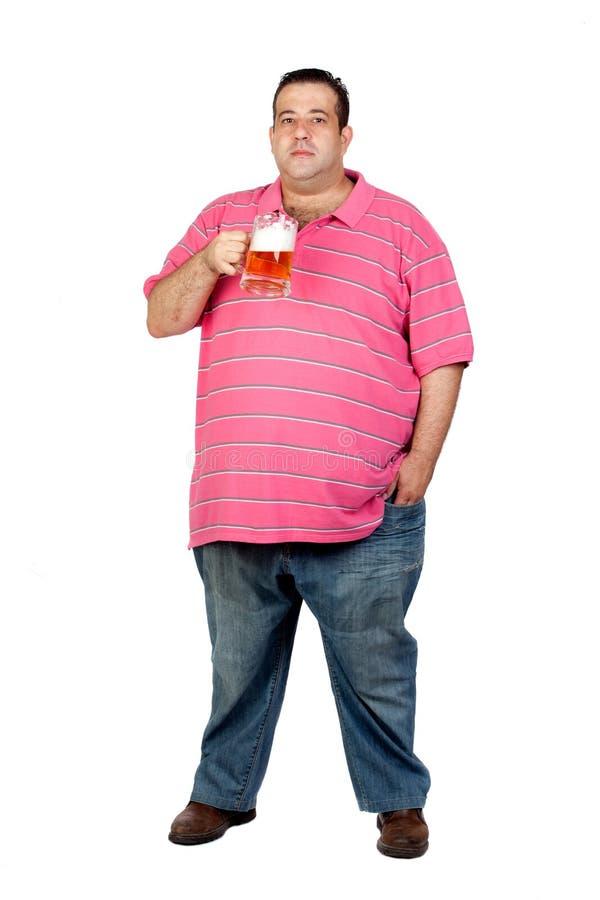 Fat man drinking a jar of beer
