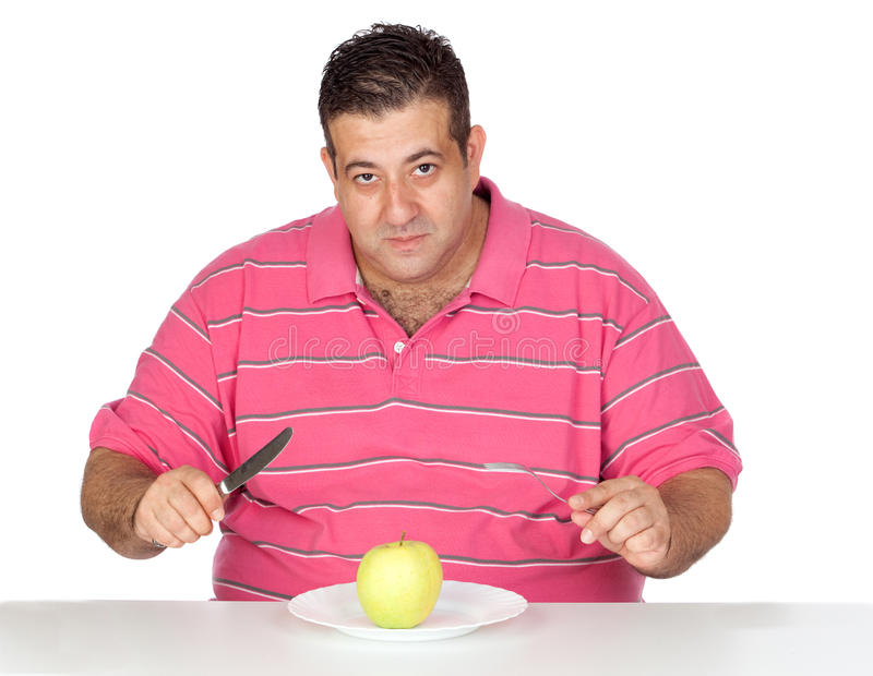 Download Fat man eating a apple stock photo. Image of medicine - 21140642