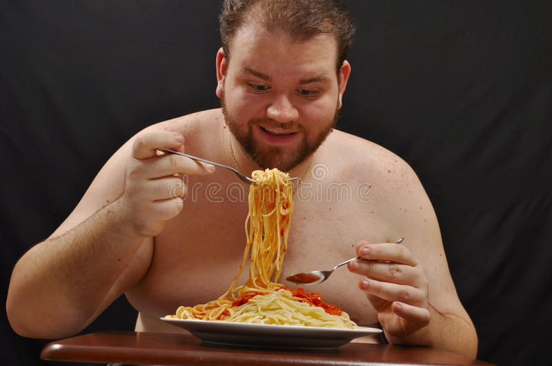Fat Man Eating Pasta Royalty Free Stock Photography