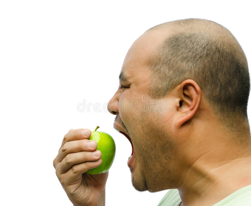 Download A Fat Man Is Forcing Himself To Eat An Apple Stock Photography - Image: 29745552