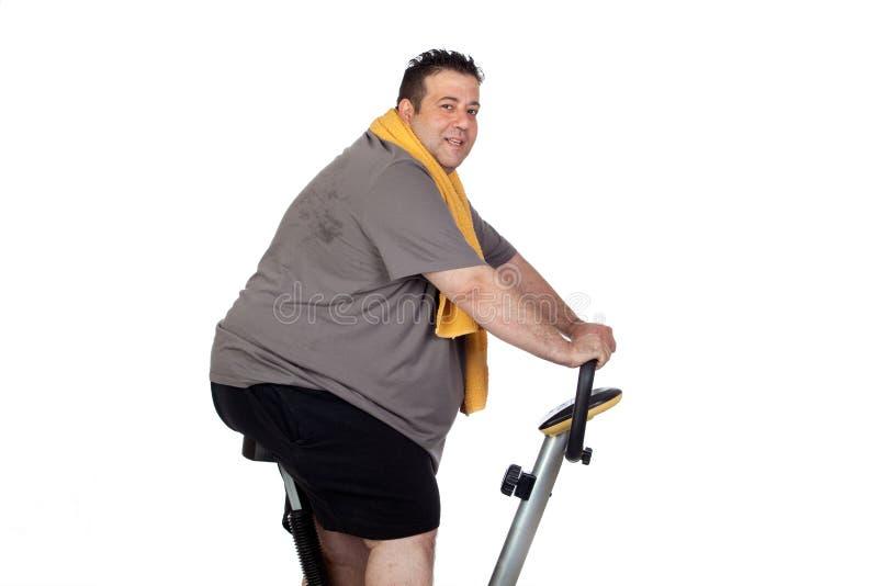 Fat man playing sport royalty free stock photos