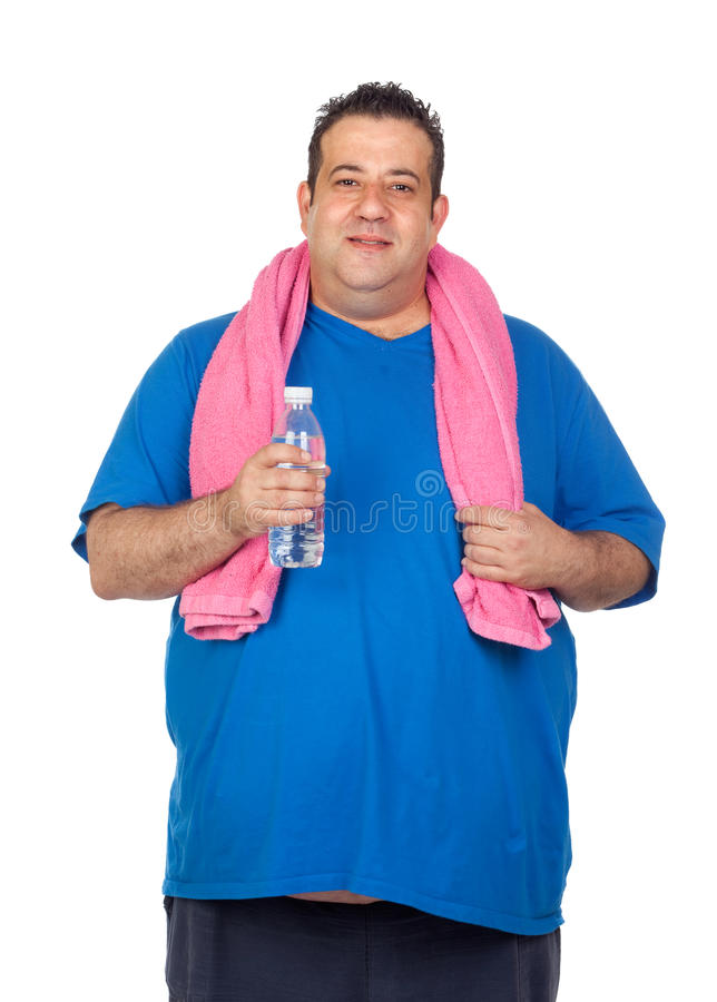 Fat man playing sport with a water bottle. Isolated on a white background royalty free stock photos
