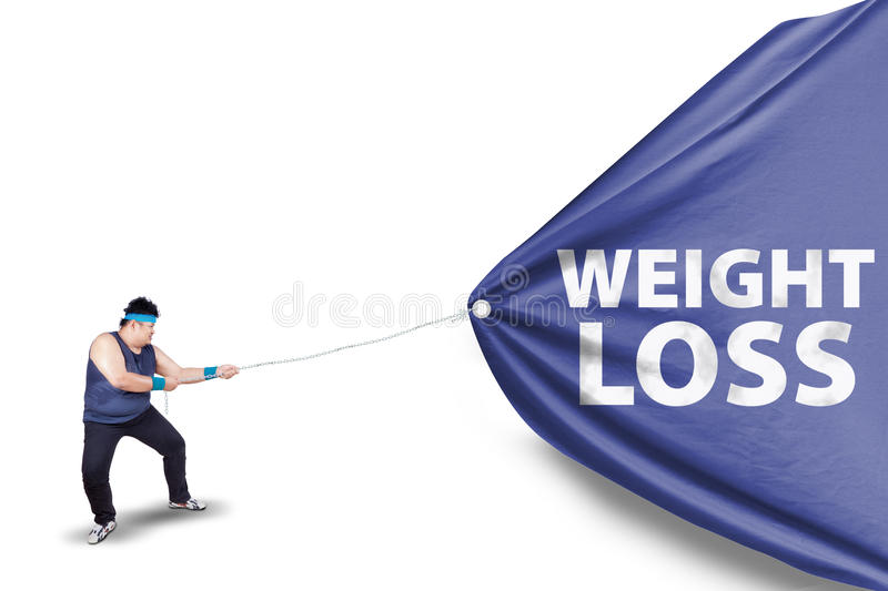 Fat man pulling a weight loss banner 2 stock photos
