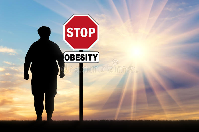 Fat man and a sign of stop obesity stock images