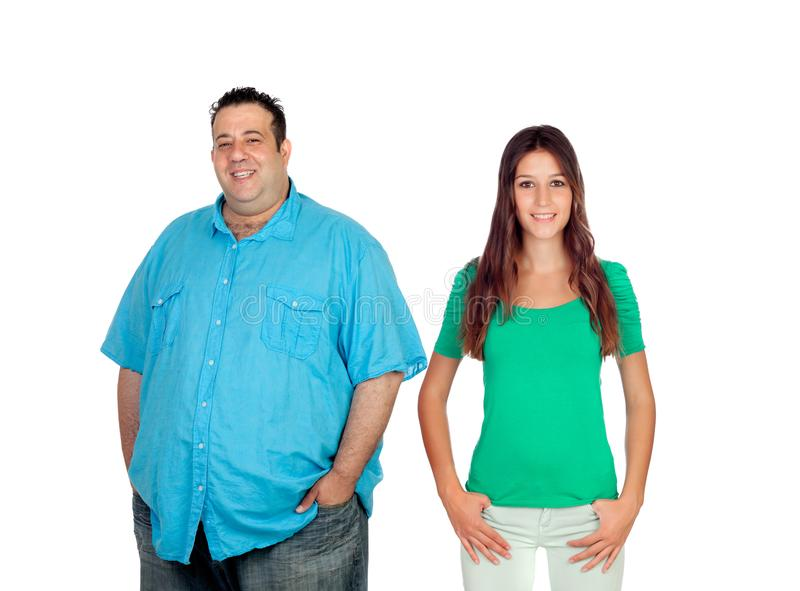 Fat man with slim woman royalty free stock photography