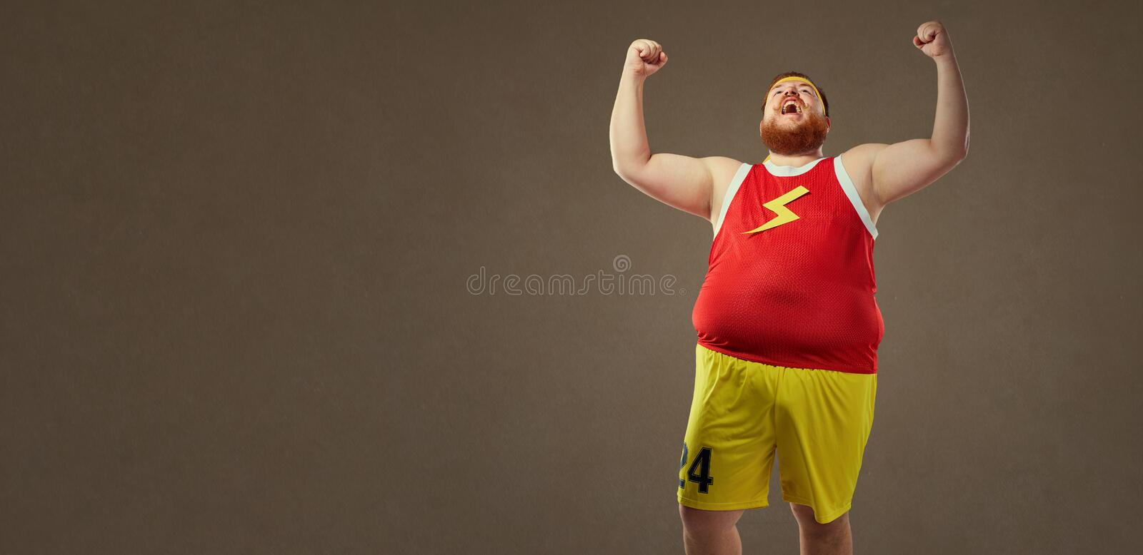 A fat man in sports clothes screams at the victory. stock image
