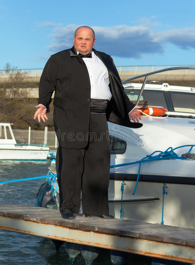 Download Fat Man In Tuxedo On Deck Boat Royalty Free Stock Images - Image: 30639199