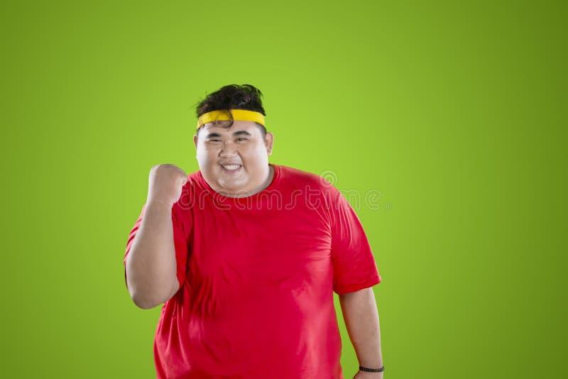 Fat man wears sportswear with happy expression stock photo