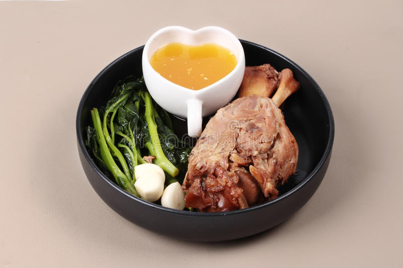 Fat out recipe of stewed pork. Fat out recipe of stewed pork, Stewed pork hock peel skin and fat out with boiled kale . Call Kha Moo Palo Rai Mun in Thai royalty free stock image