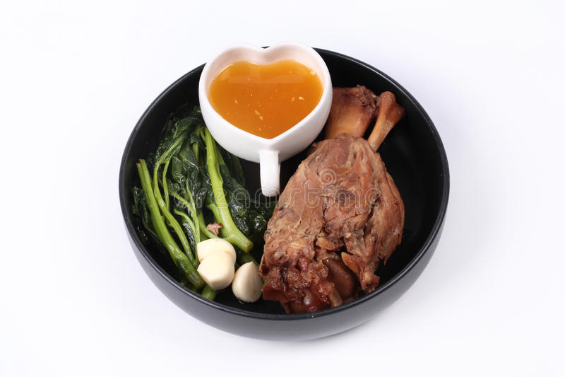 Fat out recipe of stewed pork. Fat out recipe of stewed pork, Stewed pork hock peel skin and fat out with boiled kale . Call Kha Moo Palo Rai Mun in Thai stock image