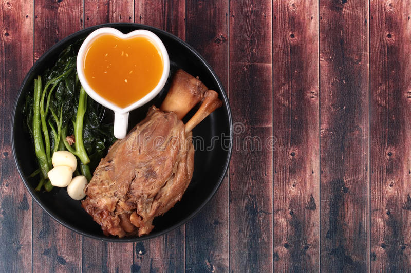 Fat out recipe of stewed pork. Fat out recipe of stewed pork, Stewed pork hock peel skin and fat out with boiled kale served on wood. Call Kha Moo Palo Rai Mun stock photo