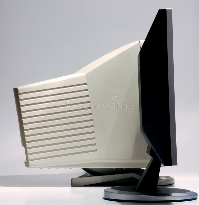 The fat and the skinny. Comparative look of LCD and CRT monitors stock photos