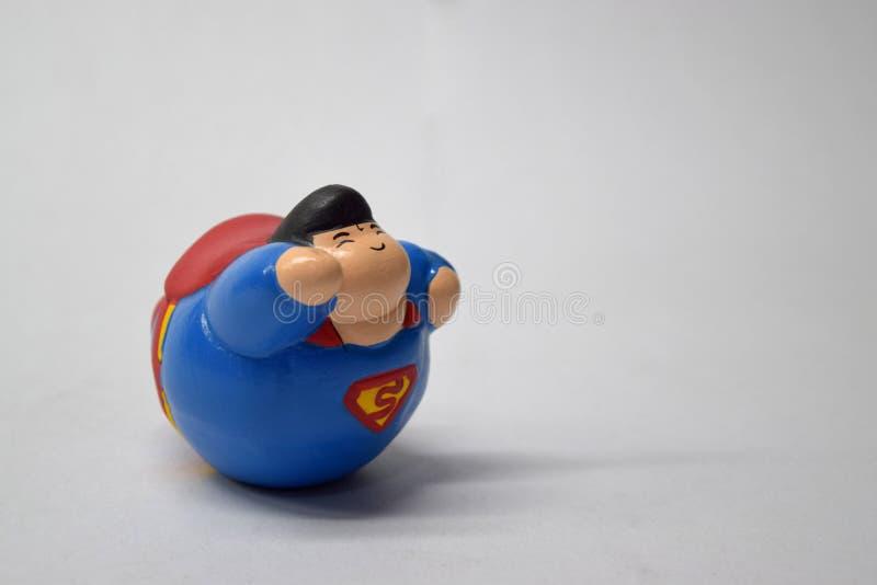Fat superman superhero vintage toy close up royalty free stock photos