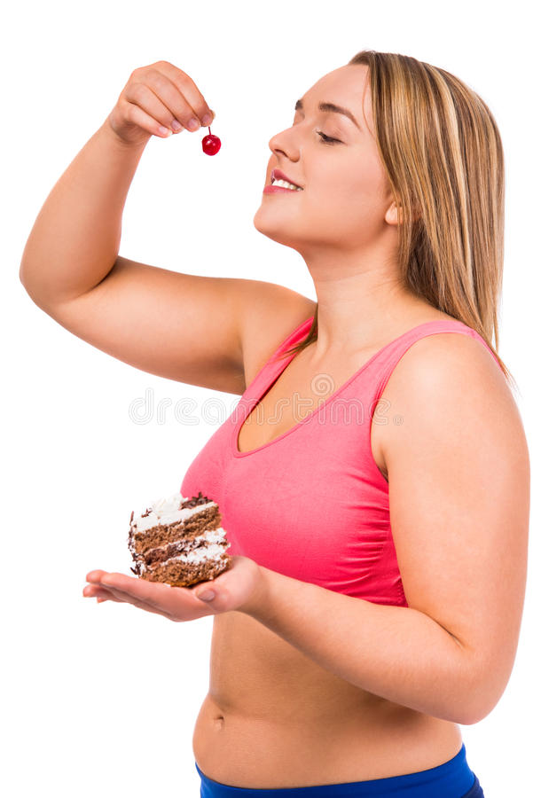 Fat woman dieting. The concept of healthy eating. Fat woman dieting isolated on a white background stock image