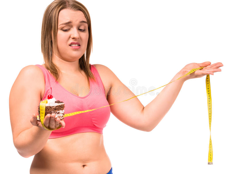 Fat woman dieting. The concept of healthy eating. Fat woman dieting isolated on a white background royalty free stock photography