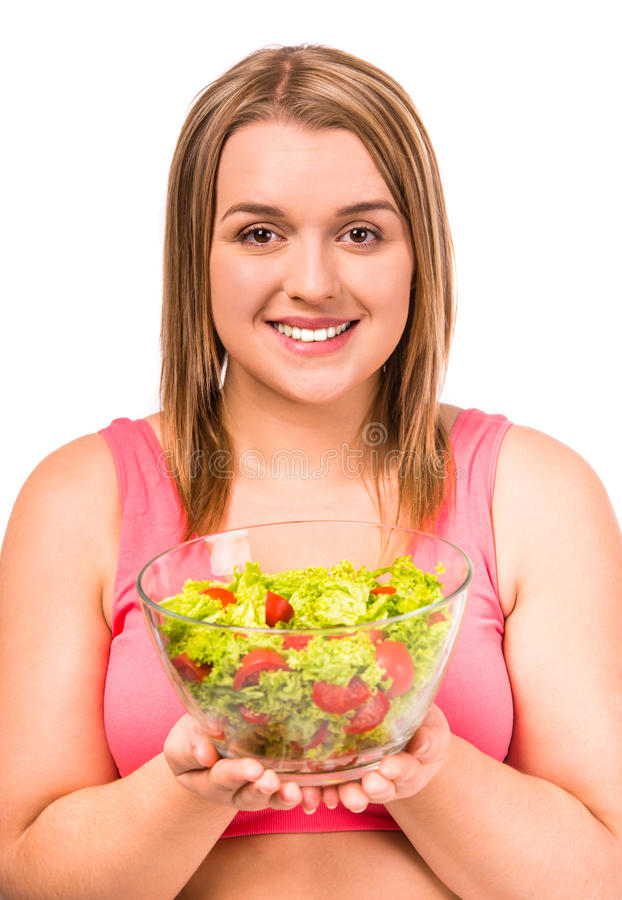 Fat woman dieting. The concept of healthy eating. Fat woman dieting isolated on a white background royalty free stock image