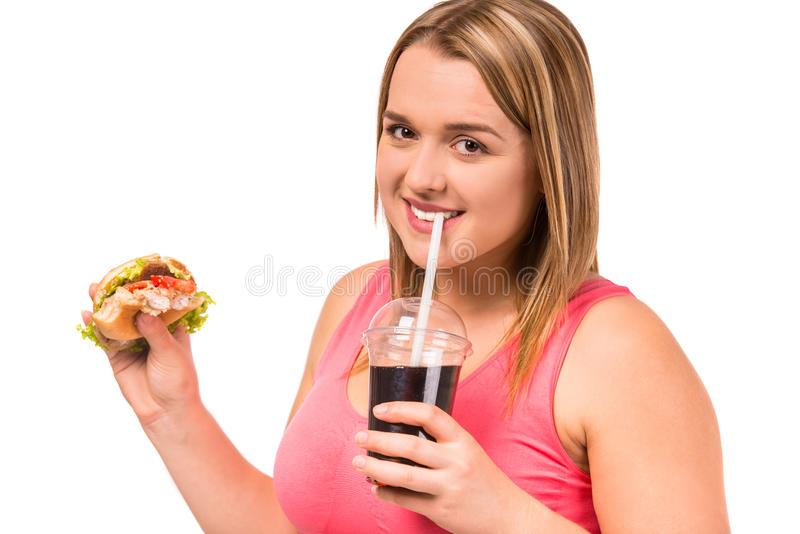 Fat woman dieting. The concept of healthy eating. Fat woman dieting isolated on a white background royalty free stock photos