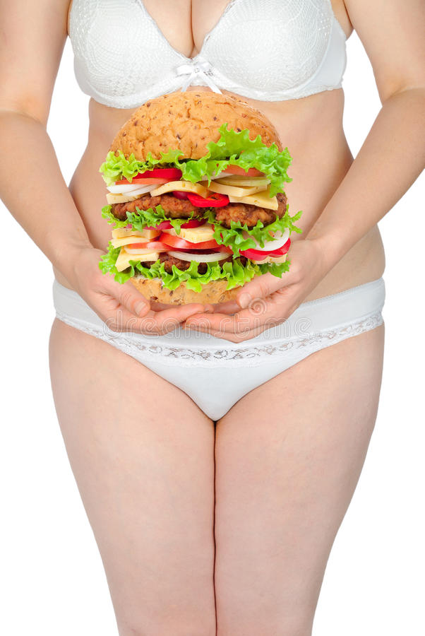 Fat woman with hamburger. On white background royalty free stock photo