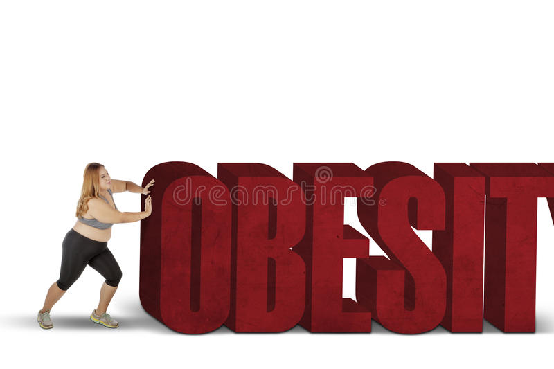 Fat woman pushing obesity word royalty free stock photography