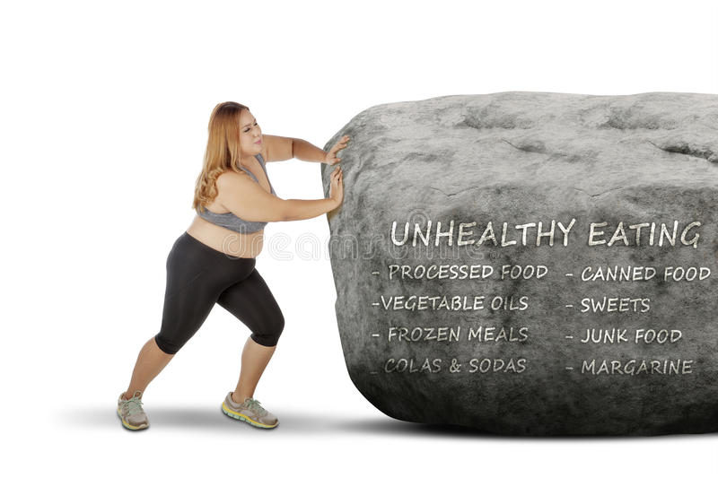 Fat woman pushing a stone with her problem stock images